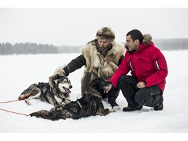 Racer Jordi Gené and trainer Susi Normand test themselves on a frozen lake in Lapland with the Leon CUPRA and six huskie