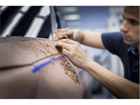 The handcrafted work of clay model makers is essential in the design process to appreciate the car's true dimensions