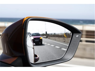 The blind spot detector activates this warning to alert the driver not to change lanes