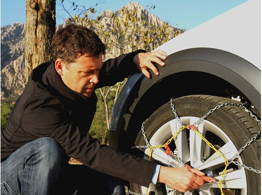 Untangle the chains, attach them first behind the tyres and tighten them as much as possible before closing them infront