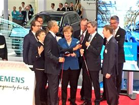 President Obama receives a golf club while visiting the Siemens booth at Hannover Messe 2016