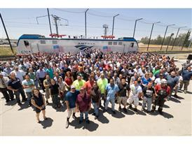 Siemens employees celebrate the 70th ACS-70 electric locomotive