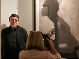 Albert Watson near Naomi Campbell picture in the Albert Watson exhibition at The Kempinski Grand Hotel Les Bains