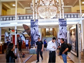 The Kempinski Grand Hotel Les Bains hall setup-for-press-conference with HP banner printed and artworks of Albert Watson