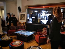The press conference setup with Hp Technology of Vantage Point, the big touch screen wall, and the Coffee Table touch, a