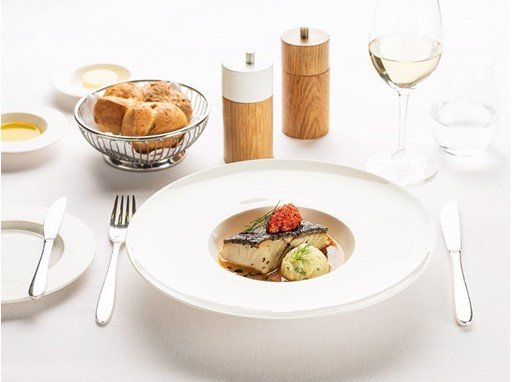 Main course in First Class: sautéed black cod fillet with seafood nage