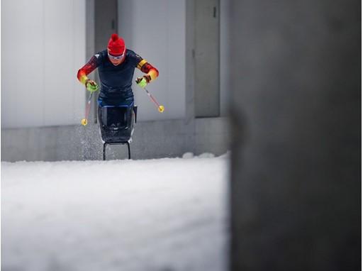 Andrew Eskau in her ski sled in training