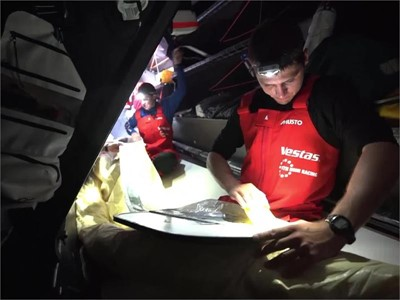 Vestas 11th Hour Racing repairing the torn A3 day 3 into Leg 2