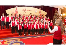 The TIS Crescendo Choir caroling at the lobby of Wynn Macau