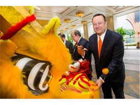 Mr. Ian Michael Coughlan, President of Wynn Macau dotting the dragon's eyes for an auspicious Year of the Monkey