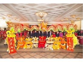 A group photo featuring Mr. Ian Michael Coughlan, President of Wynn Macau and the senior management team surrounded by t