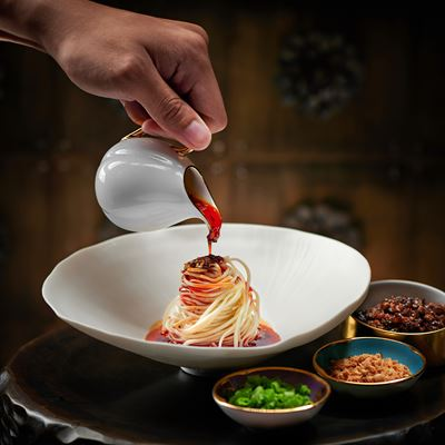 Sichuan noodles, chili oilGolden Flower at Wynn Macau Welcomes Up and Coming Young Chef Zhang Zhi Cheng