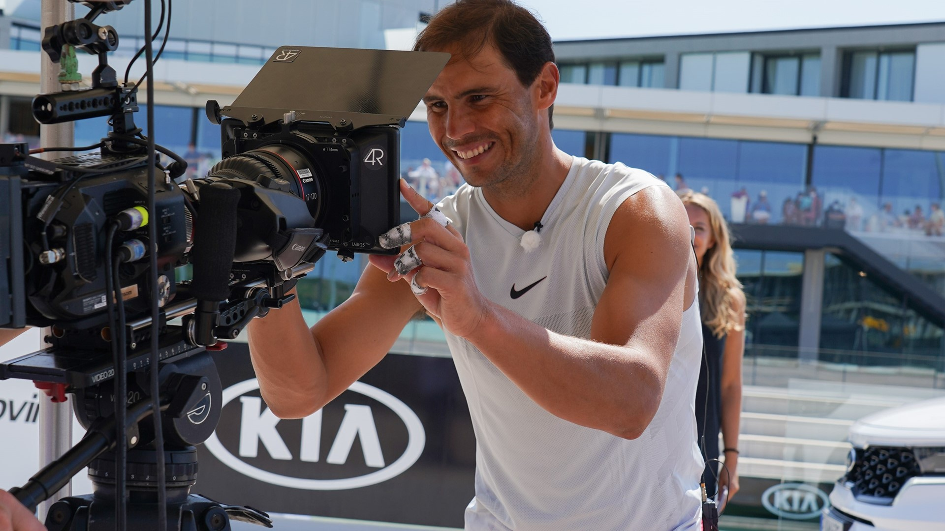Rafael Nadal signs the camera lens during a virtual signing ceremony with Kia