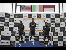 Race one podium, 2nd Palmer (L) USA, 1st Amici (Middle) Italy, 3rd Orido JAP (right)