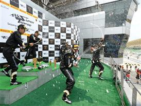 AM class winners celebrate at the podium