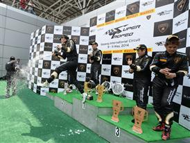 PRO-AM class winners celebrate at the podium