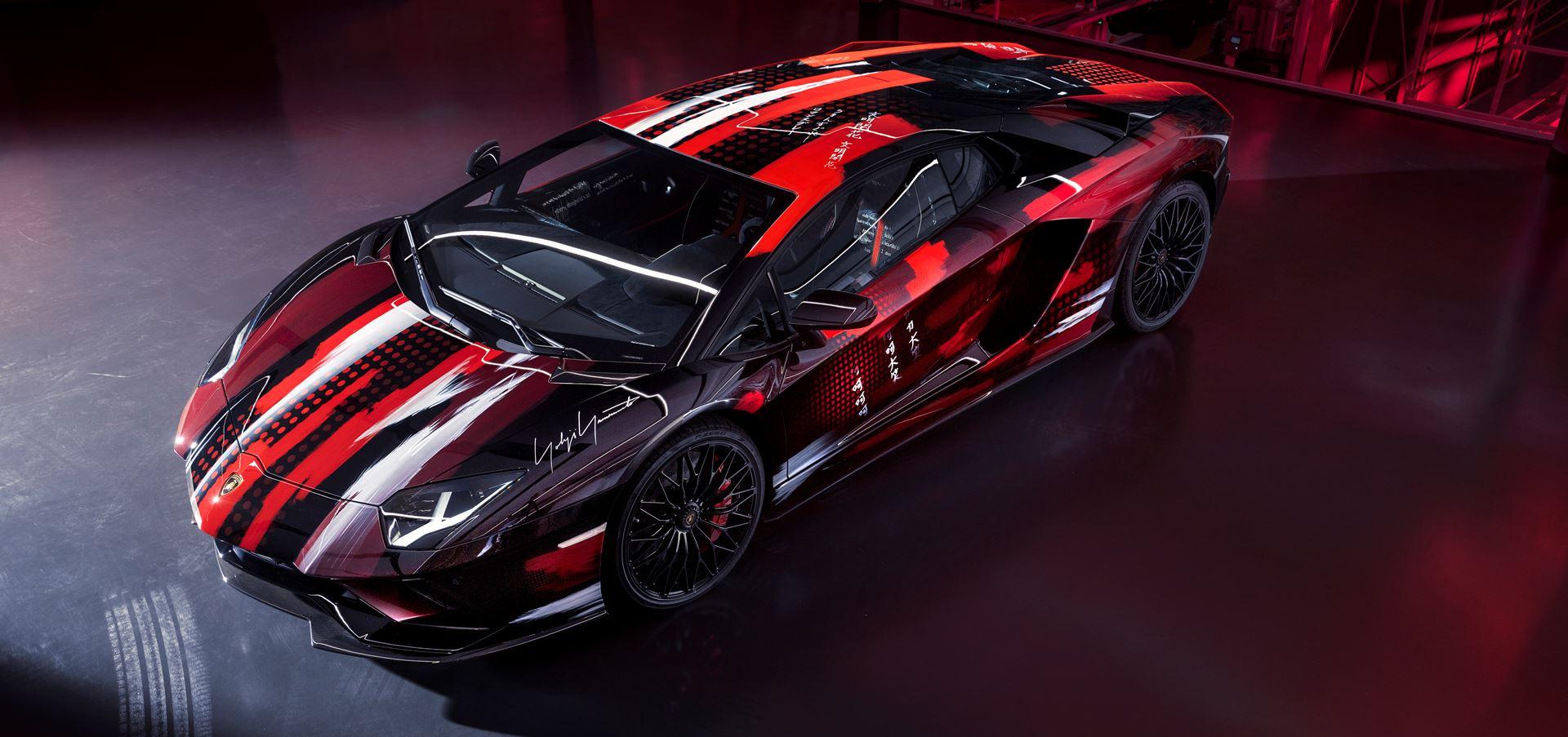 Automobili Lamborghini and Yohji Yamamoto celebrate..