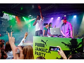 Usain Bolt entertains fans at the PUMA Jamaica Party after his arrival in Moscow