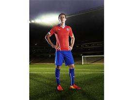 Marcos González in the 2014 Chile Home Kit that features PUMA's PWR ACTV Technology
