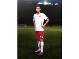 Stephan Lichtsteiner in the 2014 Switzerland Away Kit made by PUMA