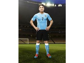 Cristian Rodríguez in the 2014 Uruguay Home Kit that features PUMA's PWR ACTV Technology