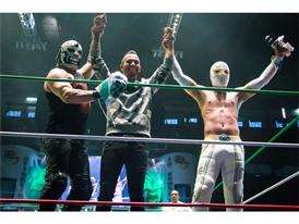 Lewis Hamilton with Lucha Libre wrestlers Mistico and Mefisto at PUMA event in Mexico City
